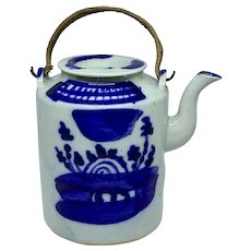 Blue and white teapot with woven handle
