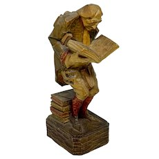 German wood carved figurine of man with books