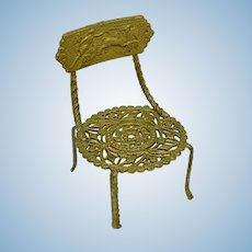Miniature soft metal chair with classical design and pierced seat
