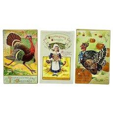 Three Thanksgiving postcards - turkey, pilgrim, pumpkin