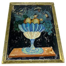 Antique tinsel painting of fruit in footed bowl