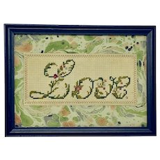 """Perforated paper embroidered floral script """"Love"""""""