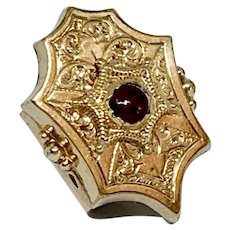Gold plated engraved slide with red paste cabochon