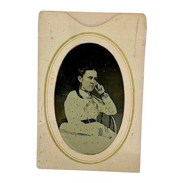 Tintype studio portrait of young woman wearing jet earrings