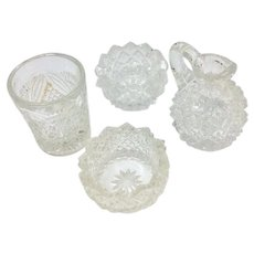Doll dishes in glass