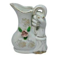Vintage vase - hand holding a pitcher