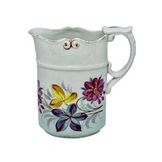 Narrow floral pitcher