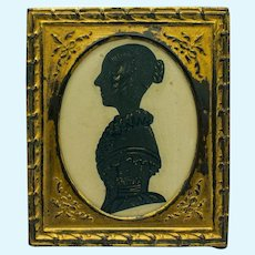 Miniature Antique Painted and Bronzed Silhouette in Pressed Metal Frame