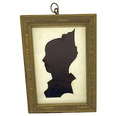 Antique hollow cut silhouette on black cloth