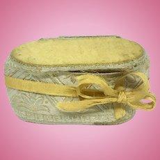 Miniature antique silk sewing kit