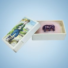 Antique needle box with miniature metal animal inside
