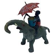 Black Americana figurine of boy riding elephant