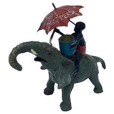 Black Americana figurine of boy riding elephant