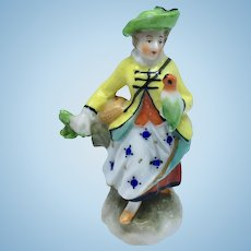 "Vienna porcelain ""Beehive Mark"" figurine of woman with parrot"