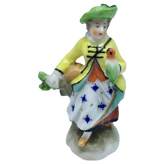 """Vienna porcelain """"Beehive Mark"""" figurine of woman with parrot"""