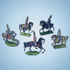 Set of five painted metal toy soldiers