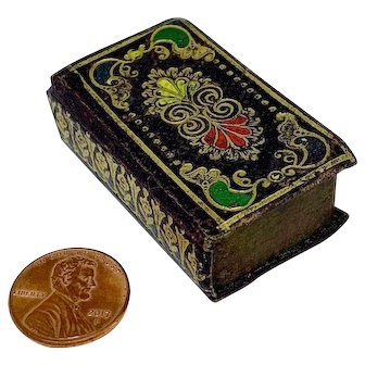 Antique gold tooled leather needle box in the shape of a book