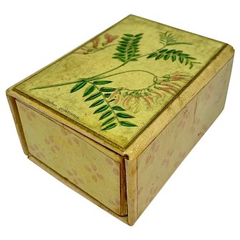 Pink paper covered storage box with botanical print