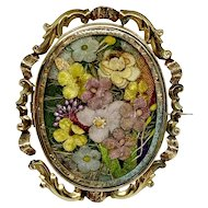 Antique glazed brooch with fabric flowers