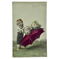 French hand colored Easter postcard - boy with Easter baskets on umbrella