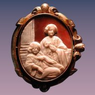 Cameo of 2 girls in prayer with locket back