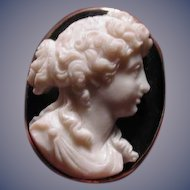 Banded agate cameo of beautiful full cheek girl