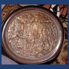 Large bronze charger with cameo scenes on it