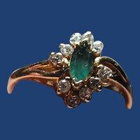 Petite diamond and emerald ring
