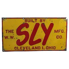 "Circa 1943-1963  'W.W. Sly Mfg. Co.' Embossed Metal 22"" Advertising Sign"