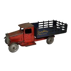 "Circa: 1930's  Metalcraft  11 3/4"" Long Toy Stake Truck Advertising ""Sunshine Biscuits""."