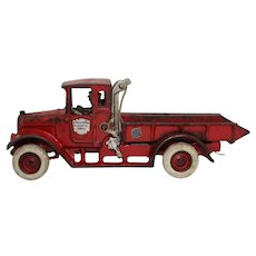 "Circa: 1929-1935 Arcade Red Baby ""International Harvester"" Cast Iron 10 3/4"" Dump Truck with Original Driver."
