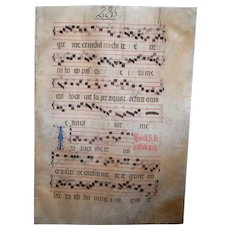 A circa 1440 AD Medieval illuminated manuscript on vellum. The vellum decorated on both sides with ornate calligraphy, illuminated complex scroll motif letters and gregorian chants.  This document is hundreds of years old and was used in an abbey as