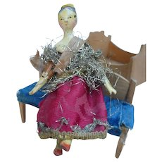 Little Grodnertal doll and its furniture