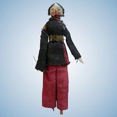 Little Grodnertal doll in military costume.