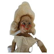 Curious old wood doll