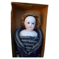 Fashion doll in costume and in its original box