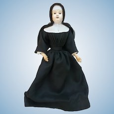 Doll with bust of germany in religious dress