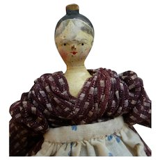 Doll grodnertal hairstyle with bun and comb circa 1820
