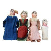 Suite of four papier maché dolls circa 1840
