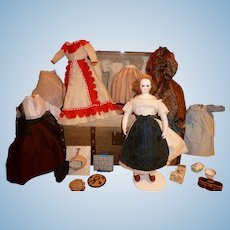 Rare little fashion doll BRU 1 ere period with trunk and trousseau.