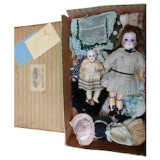 Two German dolls and their trousseaux