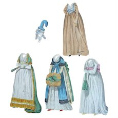 Cardboard box containing paper doll clothes