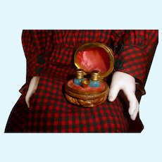Nuts containing a miniature perfume kit for dolls