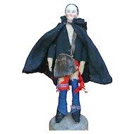 Doll figurine on base