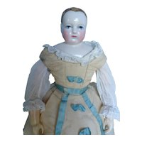 Outfit for fashion doll size 4 circa 1860 consists of two parts.
