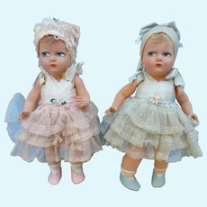 Pair of LENCI dolls in flocked celluloid.