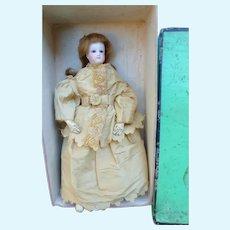 Fashion doll Size 1 in its presentation box.