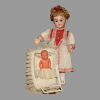 A Bluette Era Doll Carriage with ORIGINAL French Celluloid Baby