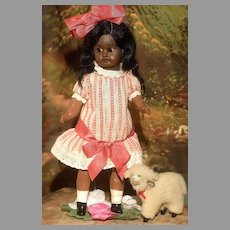"""An 8.5"""" Side Glancing Brown Bisque Recknagel Child in Very Pretty Clothes"""