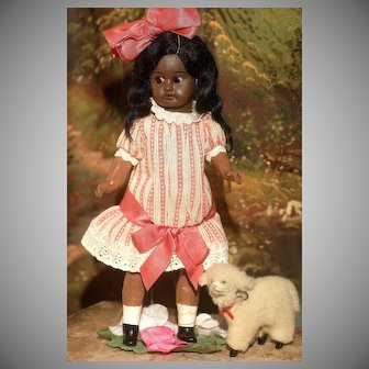"An 8.5"" Side Glancing Brown Bisque Recknagel Child in Very Pretty Clothes"